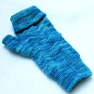 "the first mitt in ""ocean""... being knit for my friend who doesn't knit..."